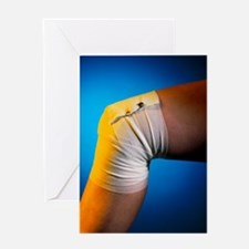 View of a bandaged knee Greeting Card