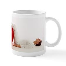 Woman using an exercise ball Mug