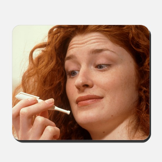 Woman holds a Nicorette nicotine drug in Mousepad