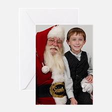 Little boy on Santas lap Greeting Card
