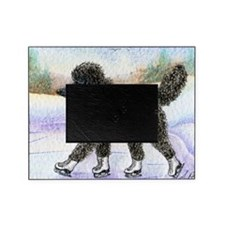 Black poodle takes to the ice Picture Frame