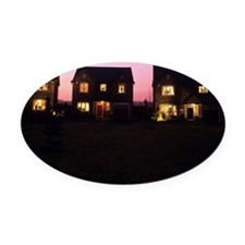Houses at dusk Oval Car Magnet