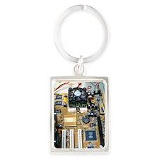 Internal parts of a personal com Portrait Keychain
