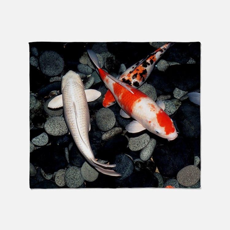 Koi carp in a pond Throw Blanket