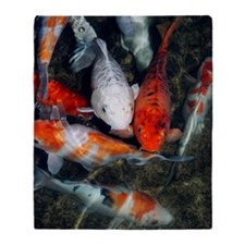 Koi carp in a pond Throw Blanket