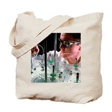 Lab technician checking drug dissolution  Tote Bag
