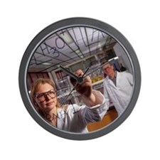 Laboratory chemist writes a chemical fo Wall Clock