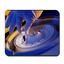 Hand loading a blood sample into a centr Mousepad