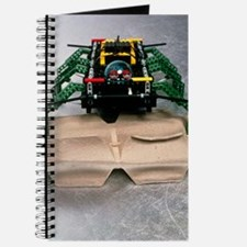 Lego robot spider climbing over a box Journal
