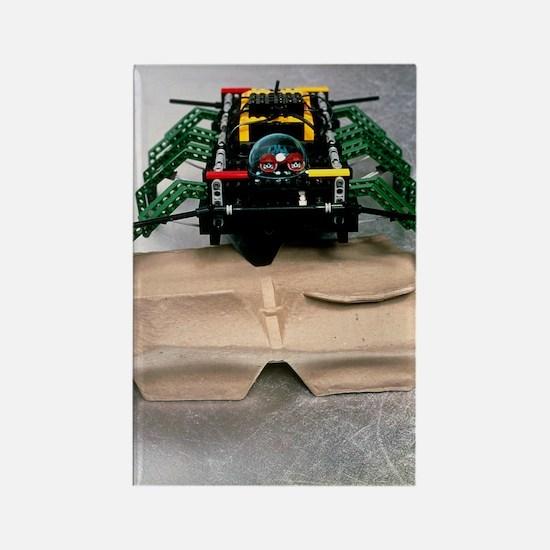 Lego robot spider climbing over a Rectangle Magnet