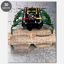 Lego robot spider climbing over a box Puzzle