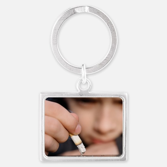 Boy playing with a cigarette Landscape Keychain
