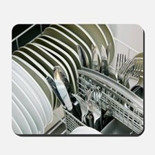 Clean utensils in a dishwasher Mousepad