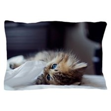 Kitten chewing on white sheets Pillow Case