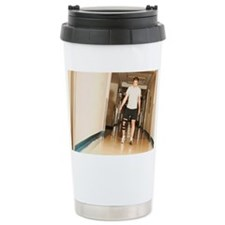 A young man walking with a knee Travel Mug