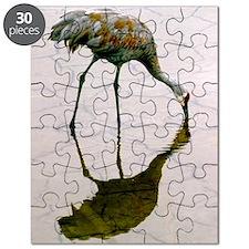 Profile of a Sandhill crane calmly feeding  Puzzle