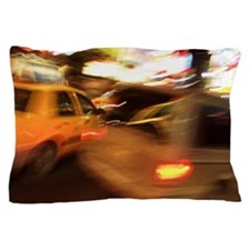 Cab in city street at night Pillow Case