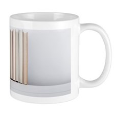 E-reader tablet sitting next to regular Small Mug