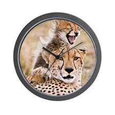Cheetah and young cubs in forest at Mas Wall Clock