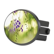Purple flower with green leaves o Hitch Cover