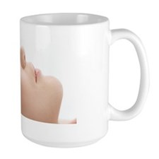Young woman relaxing having a massage i Mug