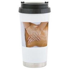 Person getting spa treatment Travel Mug