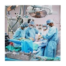 Surgeons and nurses in operating room Tile Coaster