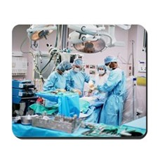 Surgeons and nurses in operating room pe Mousepad