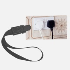 Plugs in sockets Luggage Tag