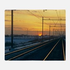 Railway at sunset Throw Blanket