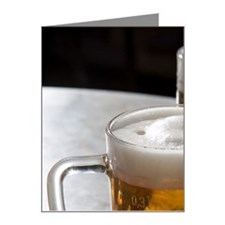 Two glasses of beer on table Note Cards (Pk of 10)