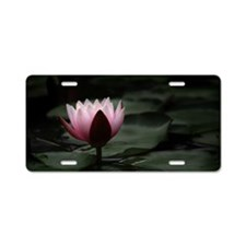 A lotus flower rises up fro Aluminum License Plate