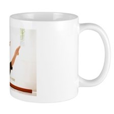 Young woman stretching Mug