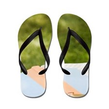 Wine glass and book on outdoor table Flip Flops