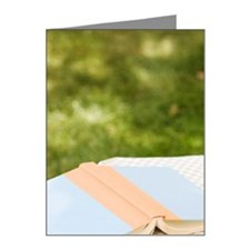 Wine glass and book on outdo Note Cards (Pk of 20)