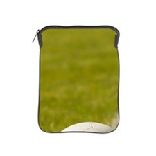 Football on white line on grass pitch, iPad Sleeve