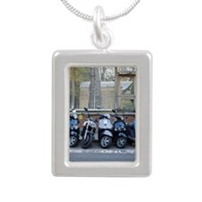 Row of parked motorized  Silver Portrait Necklace