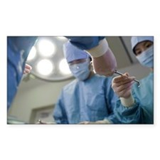 Nurse passing forceps to docto Decal