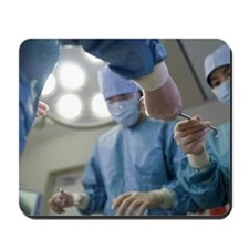 Nurse passing forceps to doctor in opera Mousepad