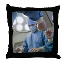 Nurse passing forceps to doctor in op Throw Pillow