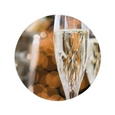 """Close up of champagne flutes and ice b 3.5"""" Button"""