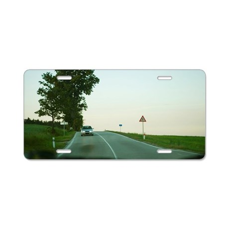 Car moving on the road, Cze Aluminum License Plate