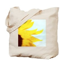 close up of the side of a sunflower Tote Bag