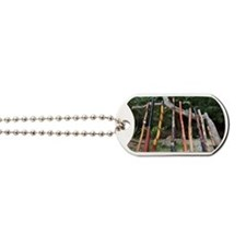 a variety of didgeridoo lined up and lean Dog Tags