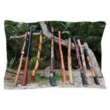 a variety of didgeridoo lined up and l Pillow Case