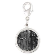 East-to-West flight crew and d Silver Round Charm