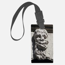 Sculpture of a deformed human he Luggage Tag