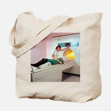 A patient is prepared for a MRI brain sca Tote Bag