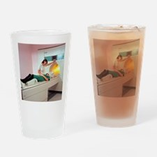 A patient is prepared for a MRI bra Drinking Glass