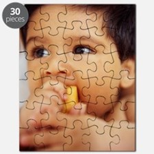 Baby boy eating Puzzle